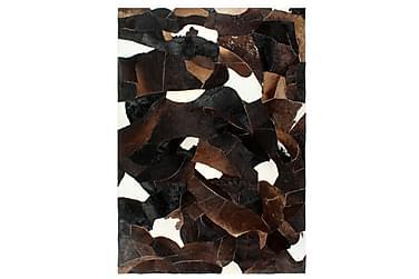 Lappeteppe ekte kuskinn med hår 120x170 cm svart/hvit/brun